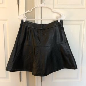 Faux leather skirt with pin hole detail.